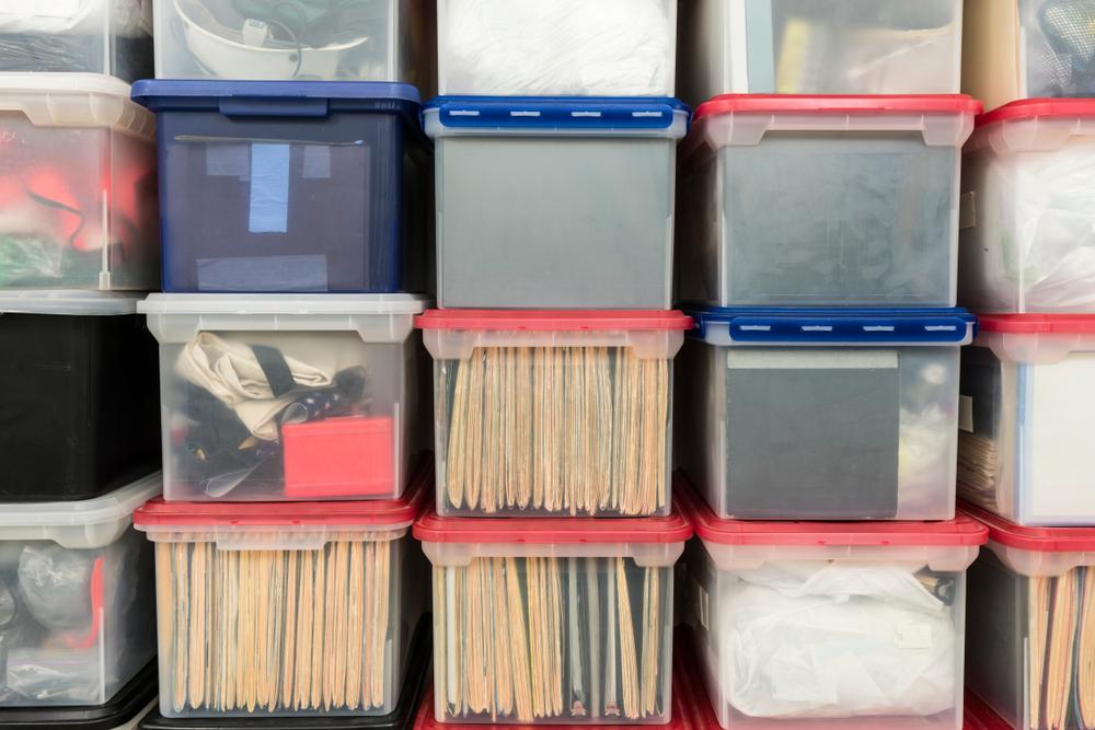 plastic storage bins with documents inside