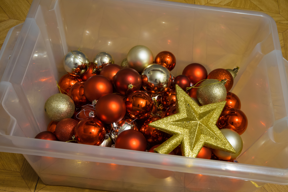 christmas decorations stored in a clear box